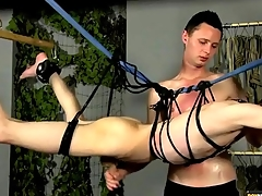 Bound twink stroked unconnected with his master