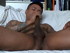 Uncaring latino tugs his cock with an increment of cums