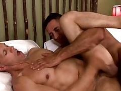 Two musle guys Nick Capra anad Rodney Steele nearly hot posture